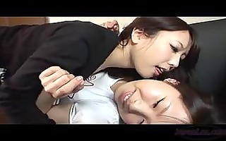 oriental gal giving a kiss getting her nipples
