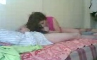 half-naked couple fucking in the bedroom