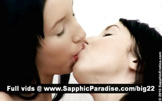 marvelous dark brown lesbos giving a kiss and
