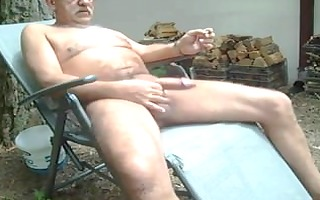 old stud jerking off outside