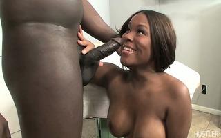 breasty dark beauty on knees engulfing penis