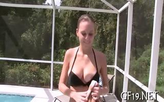 youthful gal enjoys pussy-stretch