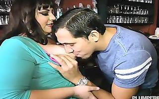 corpulent bartender bonks guy waiter in nightclub
