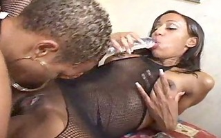 lesbo ebonys play with strap-on