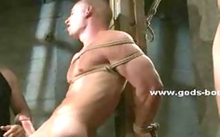 homo serf clothed just in ropes servitude