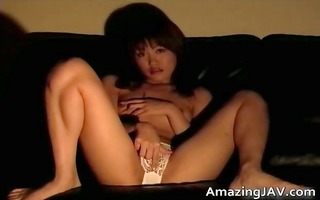 busty oriental sweetheart masturbating on daybed