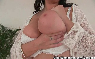 older housewife with large billibongs takes a