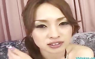 oriental cutie in bikini top getting her wet