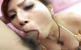 oriental cutie on her knees getting her mouth