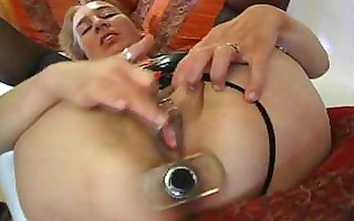dilettante milf is drilled with toys