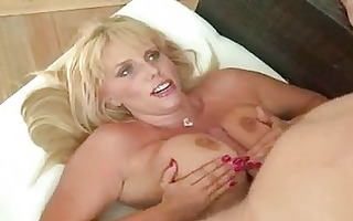 plump golden-haired with darksome corset doing