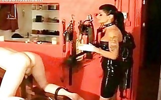latex wearing female-dom with large tits hits