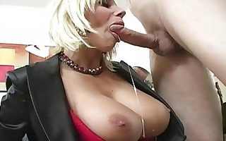 captivating breasty blond milf engulfing pecker