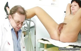 doctor inserts a speculum part0