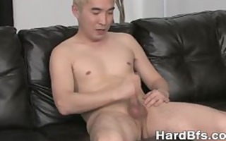 sexy oriental lad jerking off on the bed