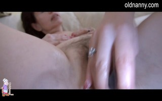 granny is enjoying sextoys with younger woman