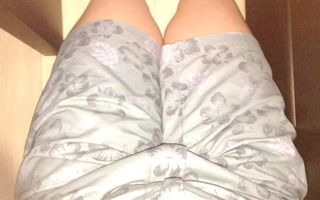 a crotch is touched where short pants are put on