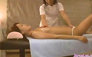 oriental cutie giving a kiss with the masseuse