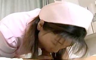 oriental nurse cares for her patient