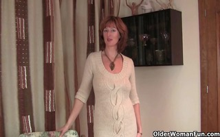 redheaded mom plays with her nipples and cunt