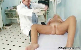 sexually excited doctor inspects a older