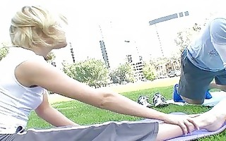 sporty blond girl doing oral-service outdoor