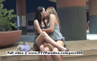 ravishing glamorous lesbos giving a kiss and