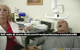 gorgeousblonde dentist looks at a pacient face