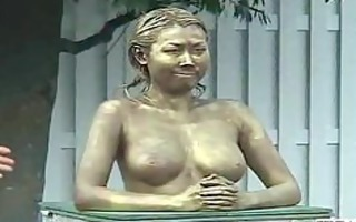 green japanese garden statue has bra buddies felt
