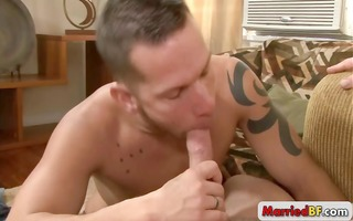 tatooed lad engulfing good jock