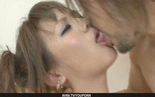 slender and indecent oriental woman making out