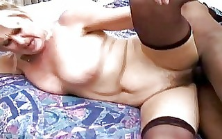 playful aged blond in stockings acquires her