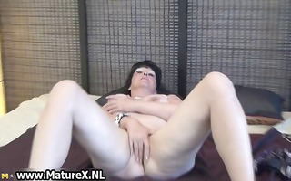 mature lady spreads her shaved fur pie